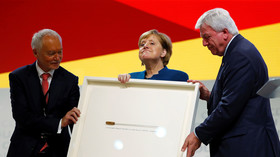 Twitter takes on Merkel over gift to mark end of her CDU party reign