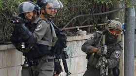 Israeli troops raid Palestinian news agency looking for footage, fire tear gas