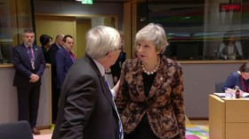 Read their lips: VIDEO of Theresa May's 'robust' talk with Jean-Claude Juncker raises eyebrows