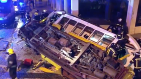 Tram derails & overturns in Lisbon, sending 26 rush-hour passengers to hospital (VIDEO)