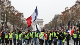 Less yellow at Champs-Elysees: Protesters march in Paris demanding Macron resign