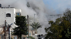Smoke rises as Israeli forces blow up the house in al-Amari refugee camp in Ramallah, in the Israeli-occupied West Bank on  December 15, 2018.