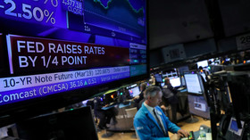 Stocks head south after Fed raises rates