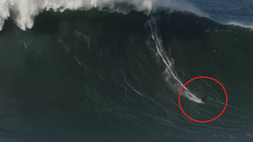 Daredevil surfer miraculously rescued between waves after wipeout on Portugal's Nazare coast (VIDEO)
