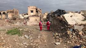 Christmas in ruins: Santas barely find kids to hand presents to in devastated Mosul (VIDEO)