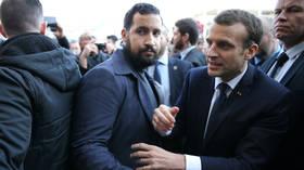 FILE PHOTO.  Alexandre Benalla stands next to French President Emmanuel Macron.