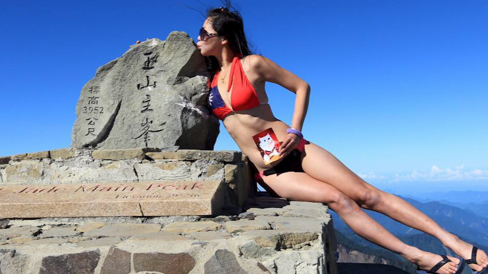 Famous bikini-clad hiker freezes to death on Taiwan mountain