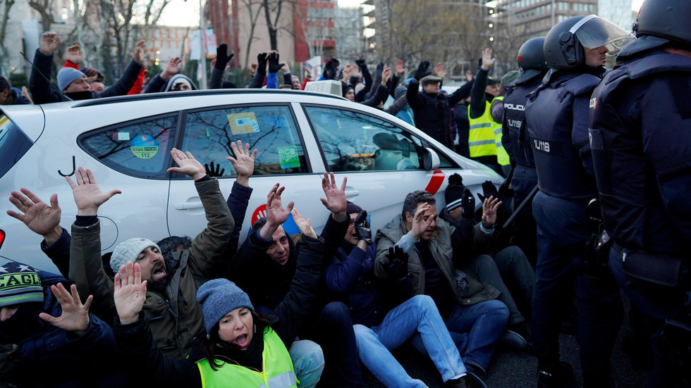Madrid taxi drivers block city center as they step up anti-Uber protest