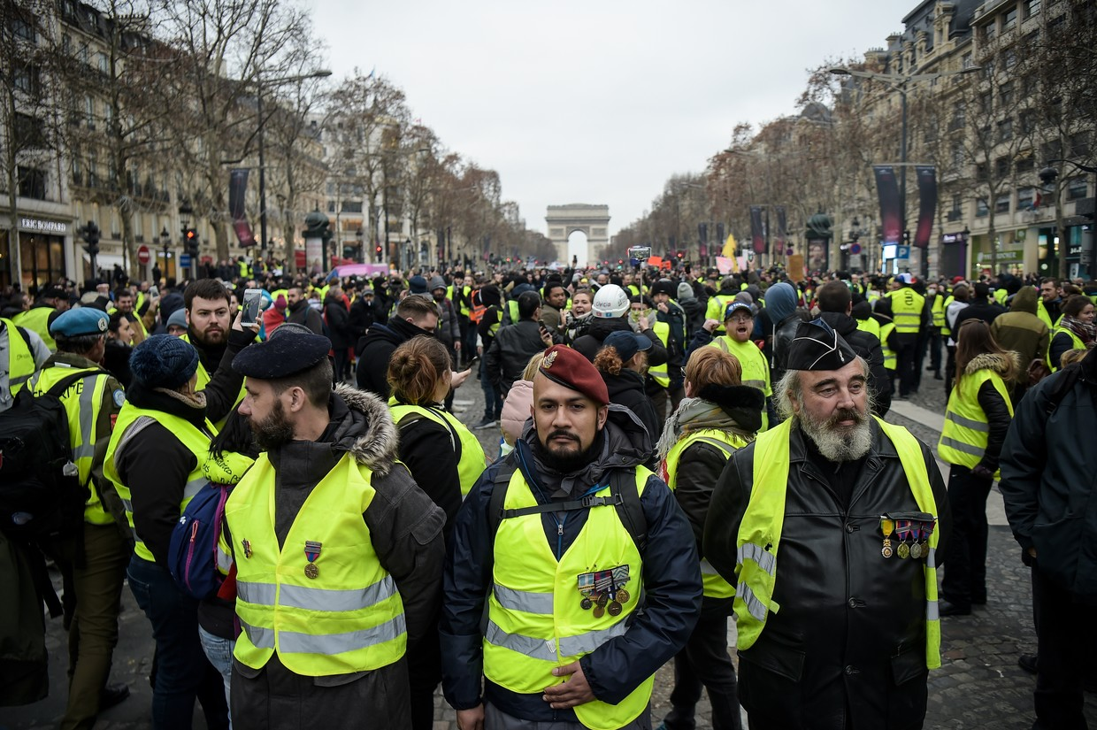 Women of French yellow vest group counter violent image
