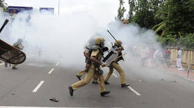 Police use tear gas at protest in India after women defy traditional ban on entering Hindu holy site