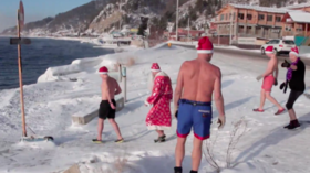 Meanwhile in Russia: Ice swimmers cheerfully plunge into chilly Lake Baikal (VIDEO)