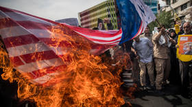 Protesters burn the US flag during a rally in Tehran, May 2018. © Tasnim News Agency / Reuters