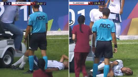 Insult to injury: Medical cart runs over stricken Brazilian player's foot (VIDEO)