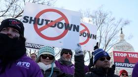 FBI protests missed pay & air traffic controllers sue as shutdown breaks records