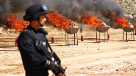 FILE PHOTO: Chinese police burn down confiscated drugs