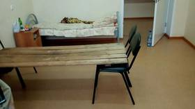 Russian hospital red-faced after PHOTOS of makeshift bed made of board on chairs sparks online fury