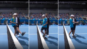 Ball boy steals show at Australian Open with 'Michael Jackson-style' coin toss (VIDEO)