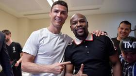Floyd Mayweather celebrates with Cristiano Ronaldo as Juventus win Supercoppa Italiana
