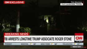 FBI agents approaching Roger Stone's front door as seen in an exclusive CNN report