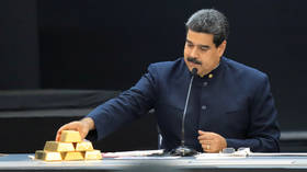 FILE PHOTO. Venezuela's President Nicolas Maduro touches gold bars.