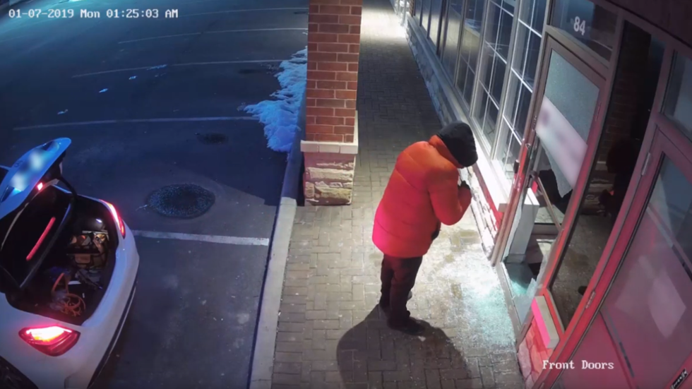 WATCH: Arsonist pours gasoline through office doors in bid to 'blow up' premises in Canada