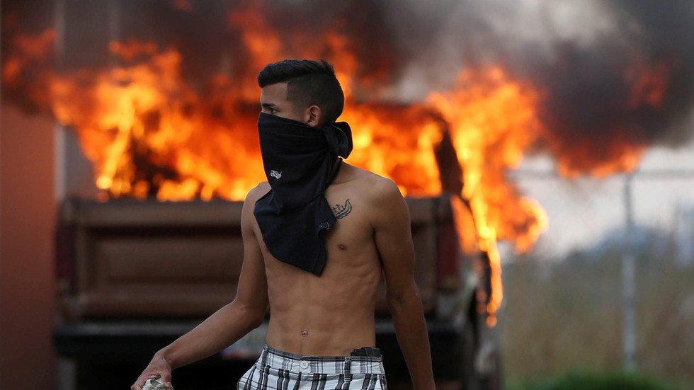 Venezuela crisis: Border clashes, 'masked thugs', 'torched aid' & fake Red Cross