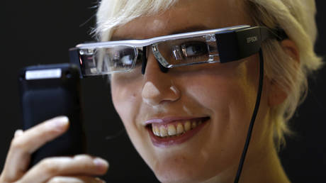 FILE PHOTO. A model demonstrates Eposon's Moverio BT-200 smart glasses. ©REUTERS / Ina Fassbender
