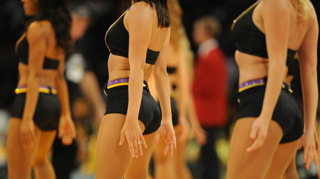 FILE PHOTO. Cheerleaders from the Los Angeles Lakers © AFP / MARK RALSTON
