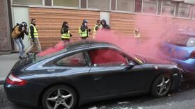 Porsches, Ferrari vandalized & set ablaze during chaotic Yellow Vest protest in Paris (VIDEOS)