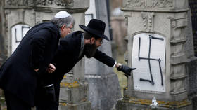 Strasbourg's Grand Rabbi inspects graves desecrated with anti-Semitic graffiti in 2018 © Reuters / Vincent Kessler