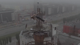 Working out HIGH: Extreme dancer performs atop 16-storey building on  SLIPPERY pole (VIDEO) — RT Russia & Former Soviet Union