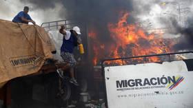FLAMES devour 'aid truck' during bridge stand-off on Venezuela-Colombia border (PHOTOS)