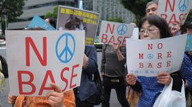 Japan's Abe says US military base to be relocated regardless of referendum results