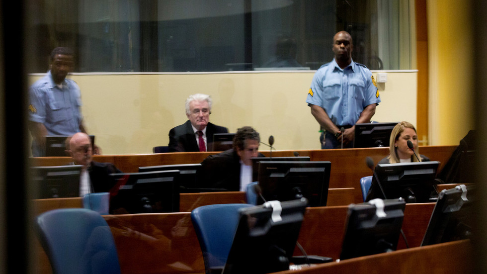 UN court increases Bosnian Serb leader Karadzic's sentence to life in jail for 'Srebrenica genocide'