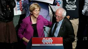 US Senator Elizabeth Warren and Bernie Sanders at the Our Revolution rally in Boston in 2017. © Reuters / Mary Schwalm