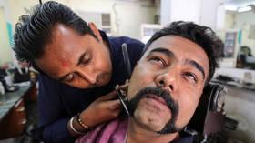 'Hero' Indian pilot inspires countrywide mustache trend