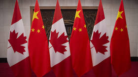 China confirms formal arrest of two Canadians after months-long detention