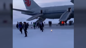Panicked Los Angeles-bound passengers trudge through snow after emergency landing in Russia (VIDEO)