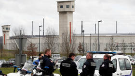 'Radicalized' French inmate brutally stabs 2 prison guards, wife dies during siege raid