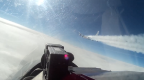 Su-27 intercepts & chases US spy plane away from Russia's borders (VIDEO)