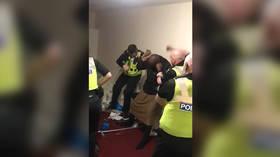 Group of 'cops' filmed beating unarmed black man in VIRAL VIDEO