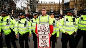 A pro-Brexit protester stands outside the Parliament in London, March 9, 2019