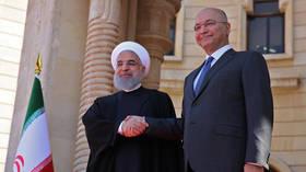 Hassan Rouhani and Barham Salih © AFP / SABAH ARAR
