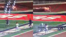 Referee dodges death as 80ft light pole crashes onto him at high school game (VIDEO)