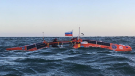Russian adventurer survives hurricane-force winds on a solo rowboat as he scrapes through Pacific