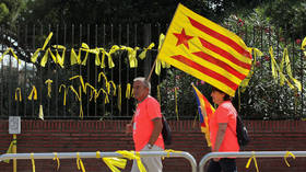 Spain launches disobedience probe into Catalan leader over pro-independence symbols