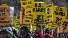 Demonstrators and activists gather to protest against a US led intervention in Venezuela in front of the White House on March 16, 2019.