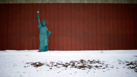 A scaled down version of the Statue of Liberty is seen on the side of the road in Jewell, Iowa, United States