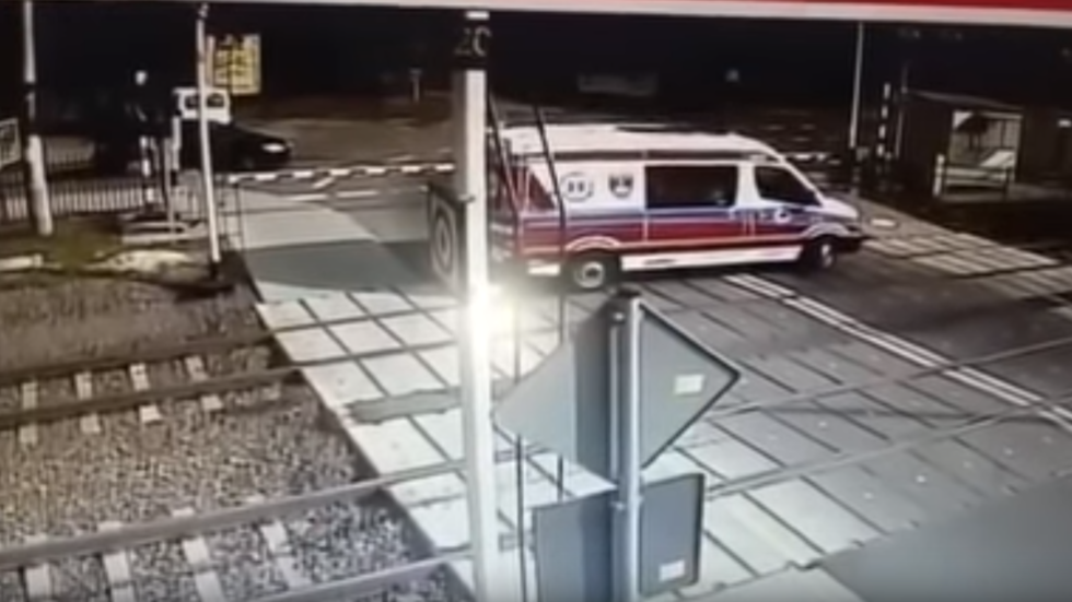Shocking footage captures deadly collision between ambulance and train