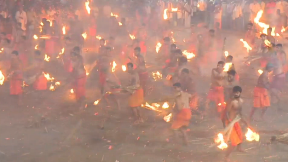 Fight fire with fire: Hundreds of Indian men try to set each other ablaze to appease goddess